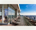 Spacious 1 bedroom with high ceilings. Washer/dryer in unit - Glass enclosed roof-deck
