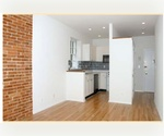 Lovely two-bedroom with exposed brick walls and hardwood floors.
