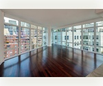 Place 57 Condominium. Incredible Three Bedroom, Three Bathroom with Sweeping City Views. 